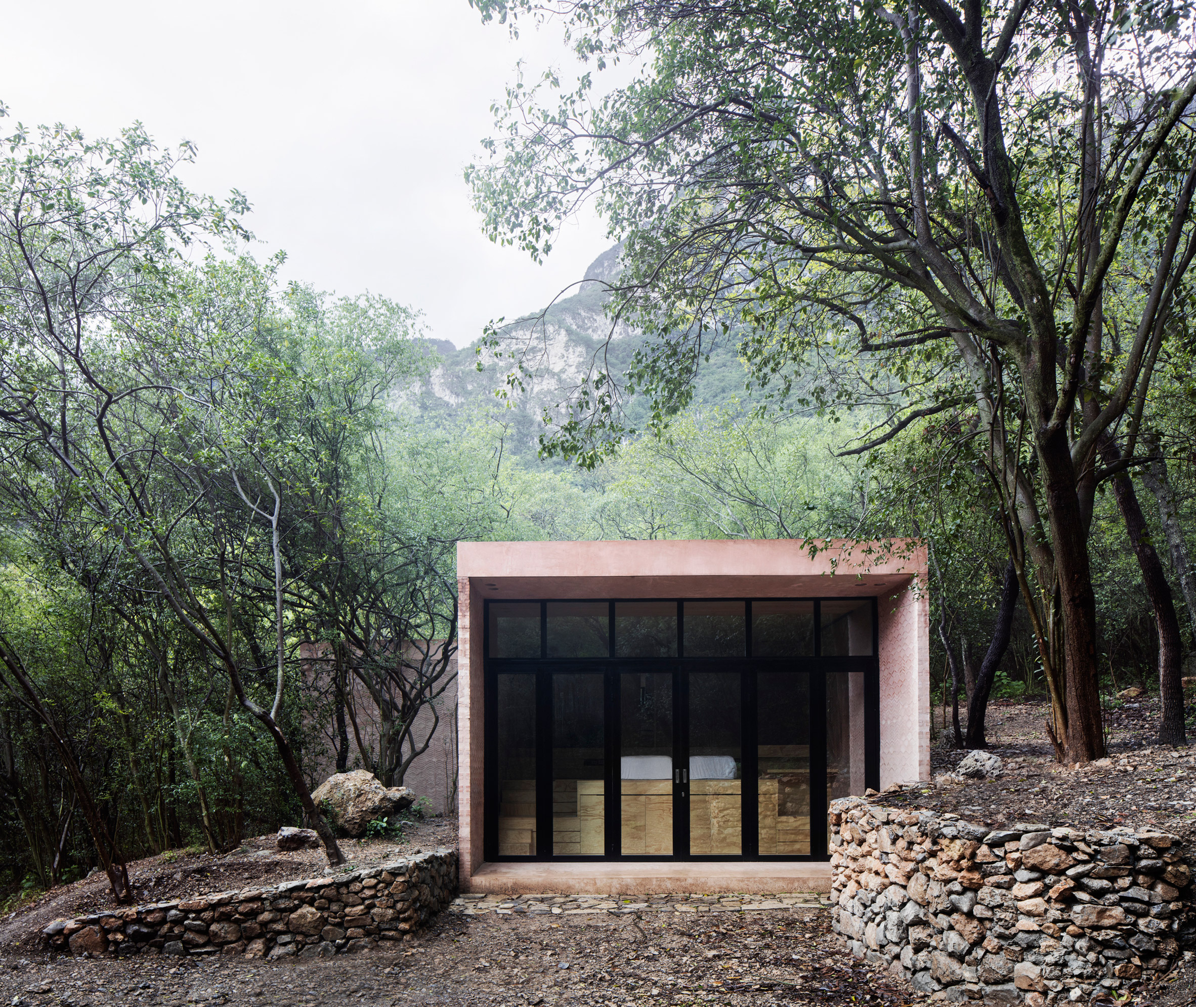 Reflective holiday home by Tatiana Bilbao hides among trees in Mexico