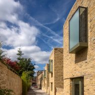 Peter Barber Architects uses oriel windows to animate the facades of Moray Mews houses