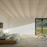 Oxygen house by Susanna Cots uses oak and stone to reference its natural setting