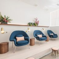 Content Architecture furnishes Paloma nail salon in Texas with comfy blue chairs and brass details