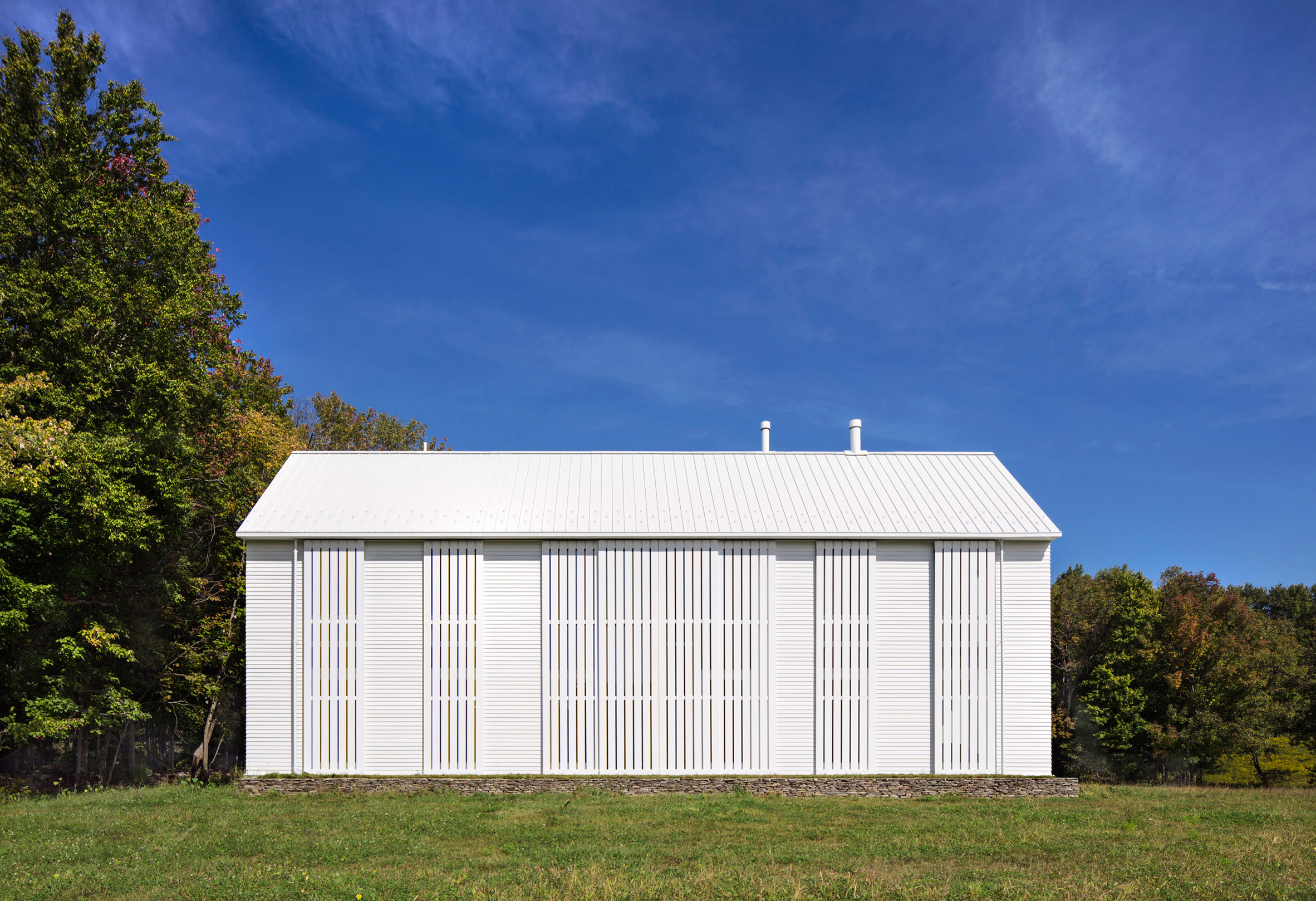 Huge rolling shutters shade pennsylvania farmhouse by for Anderson architects