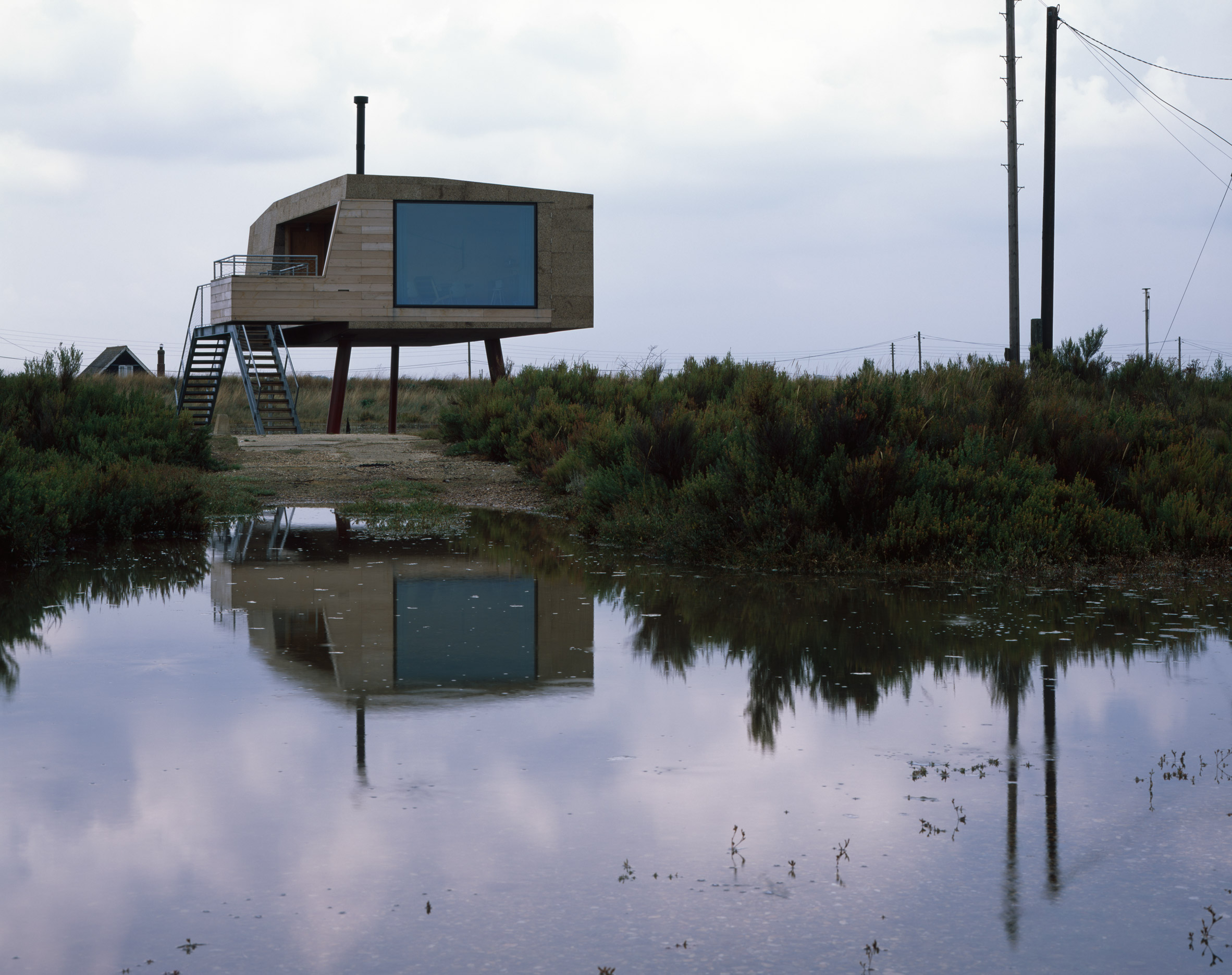 Redshank artist's studio is a cork-clad cabin raised above a tidal salt marsh