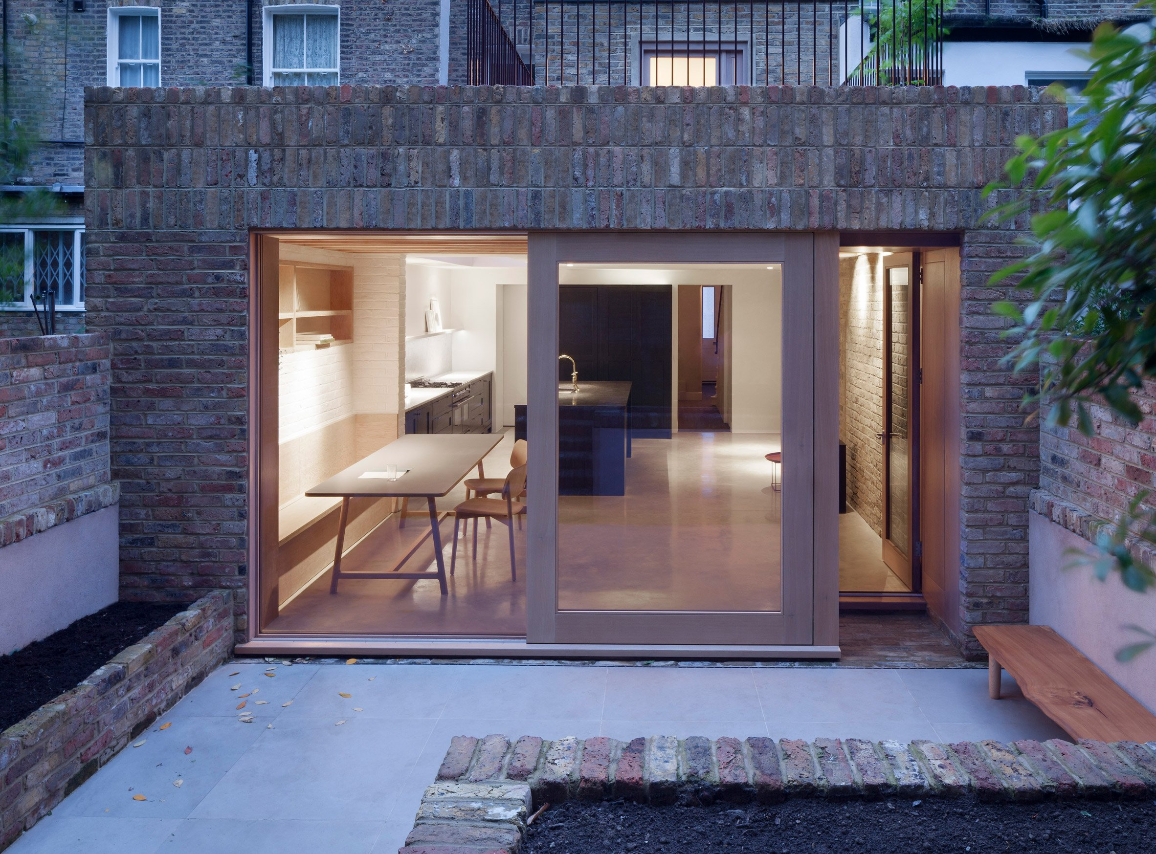 Timber and textured-brick surfaces soften interior of extension by O'Sullivan Skoufoglou Architects