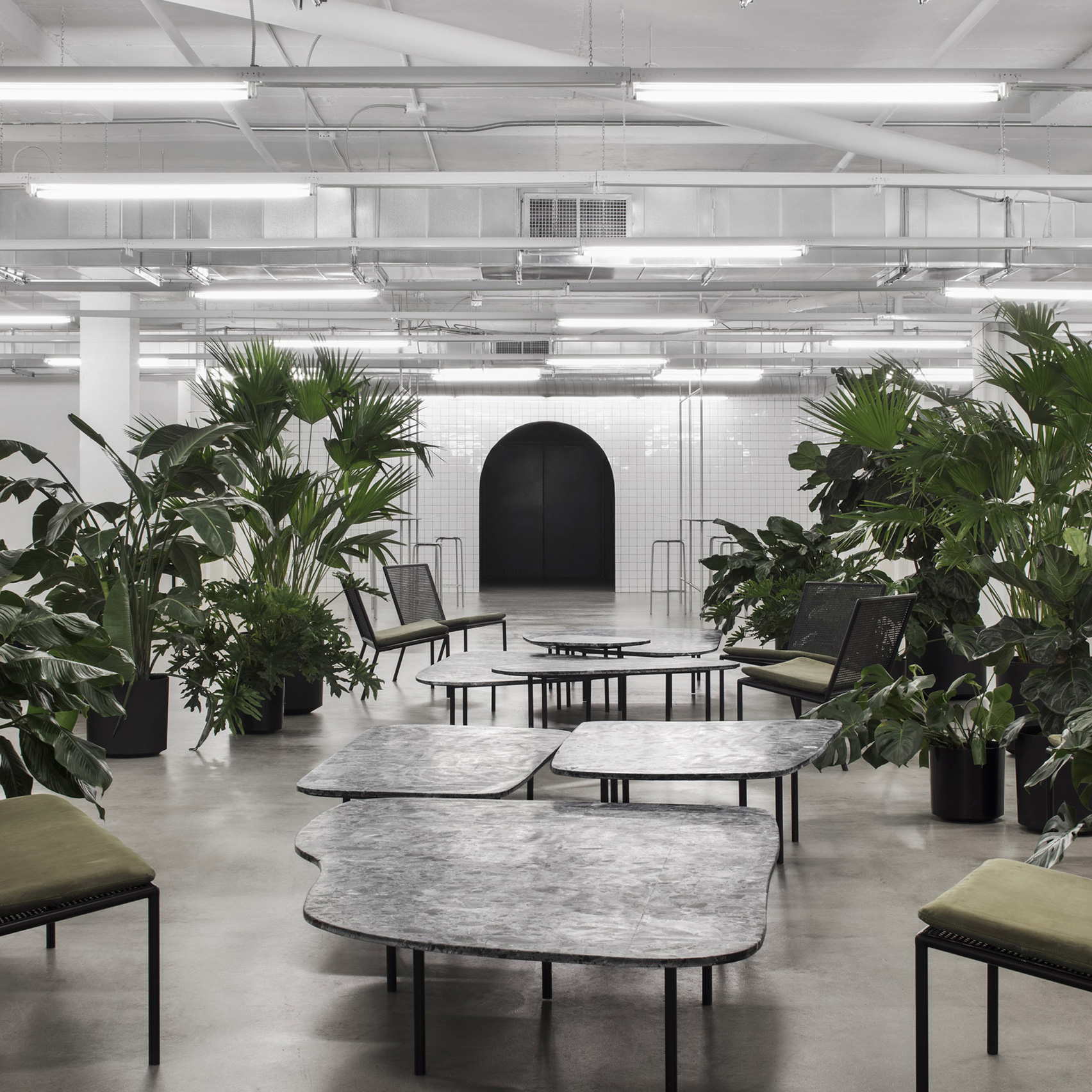 Atelier Barda combines foliage with bespoke furniture at fashion brand  offices