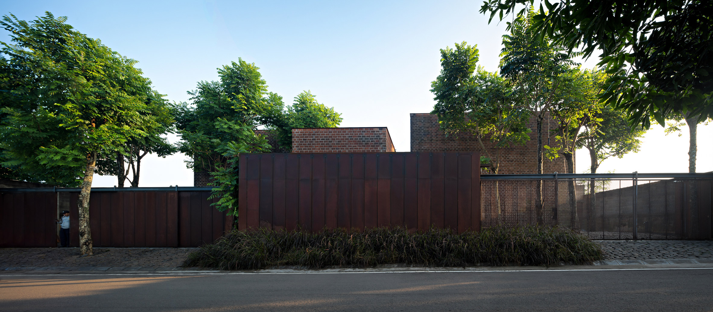 Studio Air Putih combines brick with rusted steel and concrete at Jakarta offices