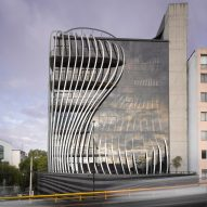 Aluminium strips curve through Mexico City building by Belzberg Architects