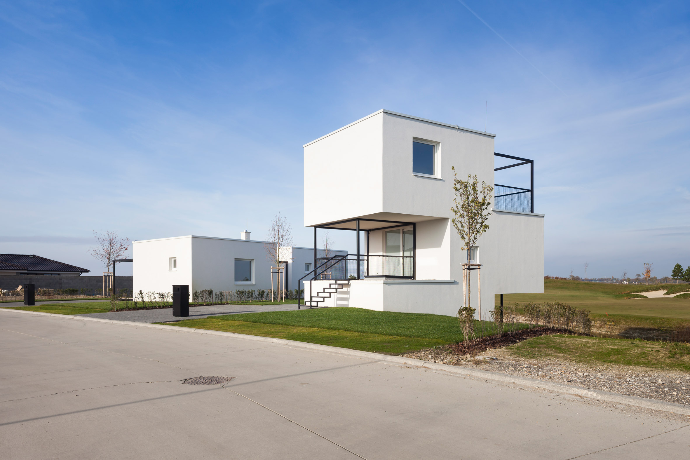 Endorphine connects white boxes with black frames to create homes at Slovakian golf resort