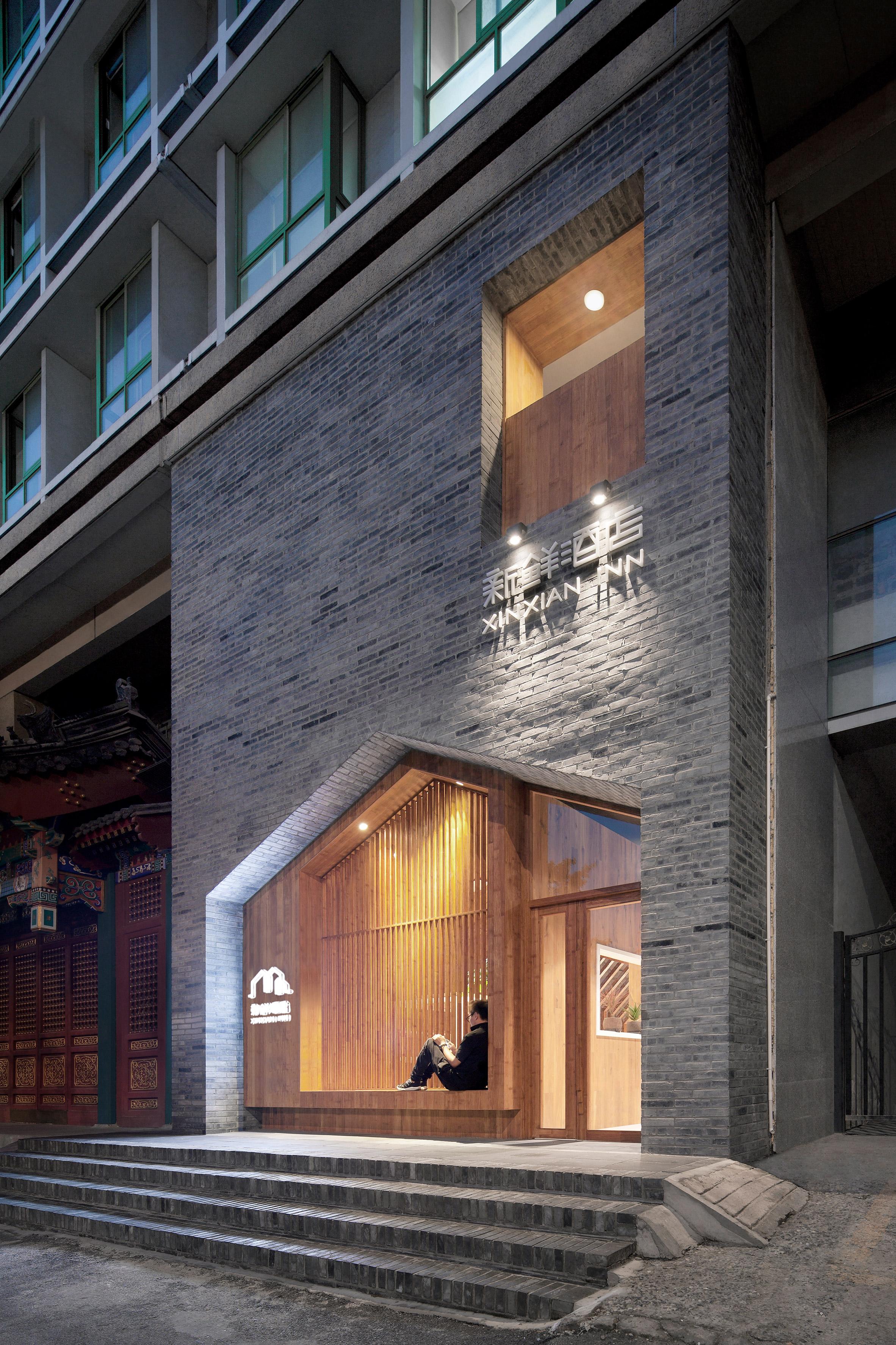 Penda inserts house-shaped opening into facade of hotel in Beijing's XinXian Hutong