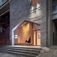 Penda inserts house-shaped opening into facade of hotel in Beijing's XinXian Hutong