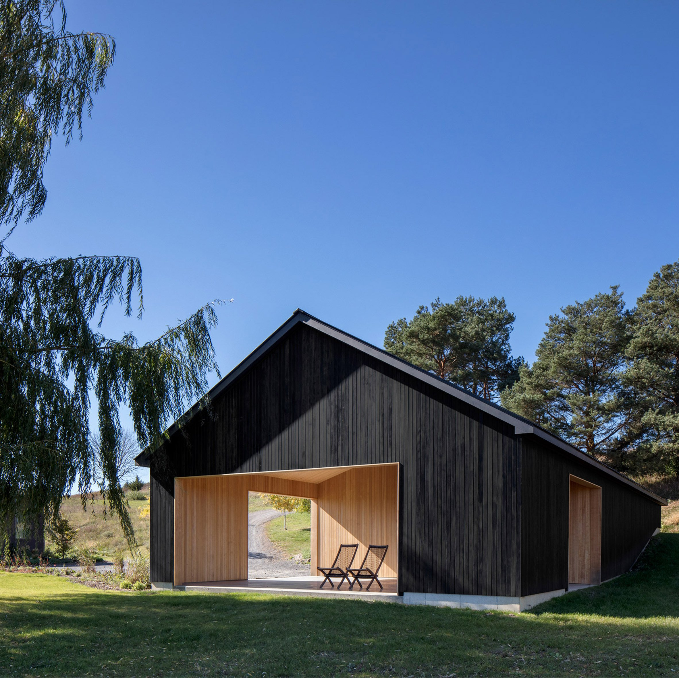 worrell yeung adds minimalist black barn to traditional property in upstate new york