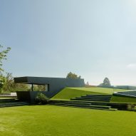 Grassy landscape cascades over angular Los Angeles house by Eric Rosen