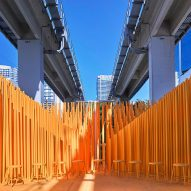 Architecture students install bright orange stage below Miami transit station