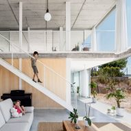 Sliding glass doors open concrete house by Narch to views of national park near Barcelona