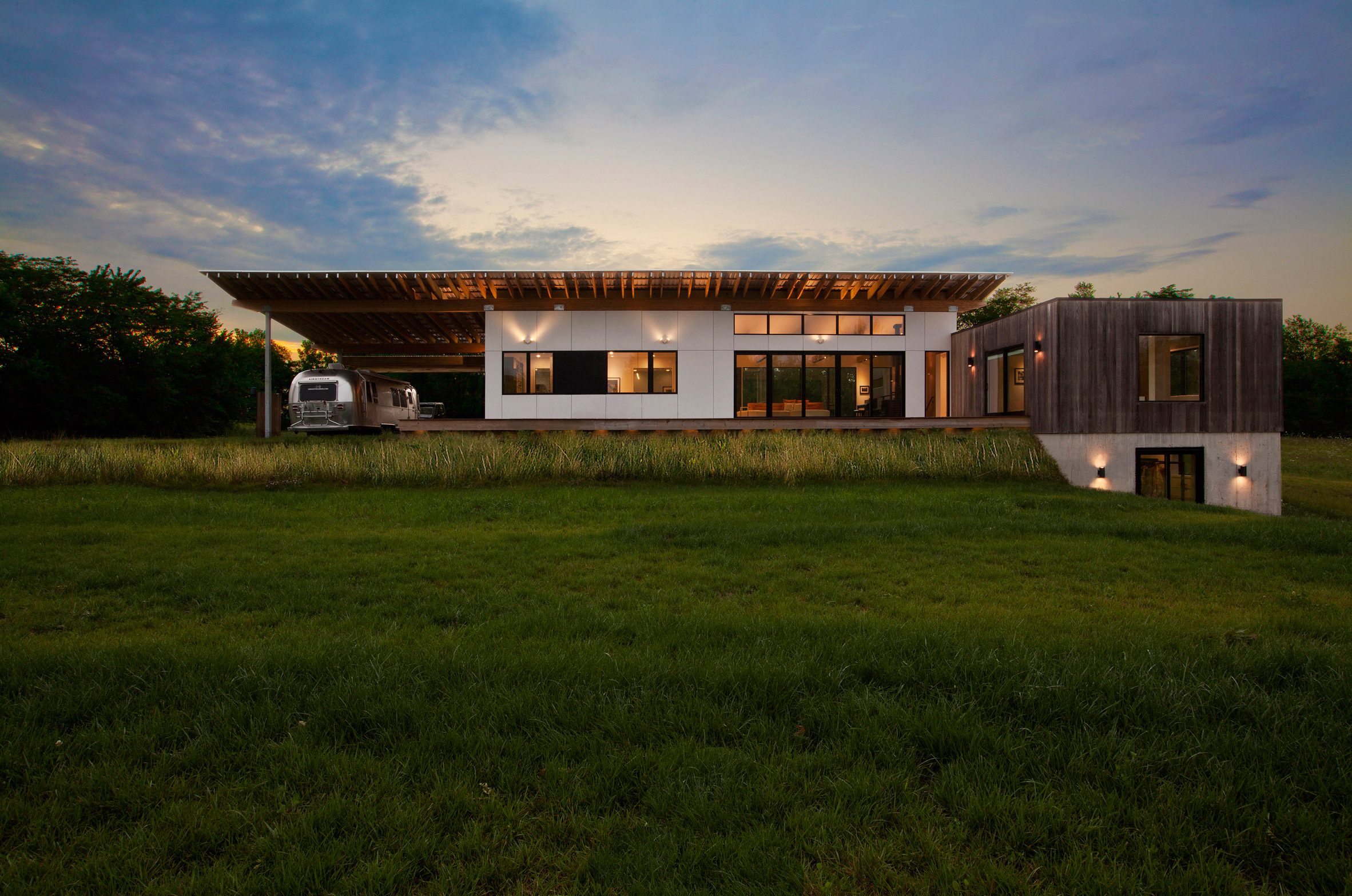 Haus wraps low-lying Indiana residence in thermally treated ash ...