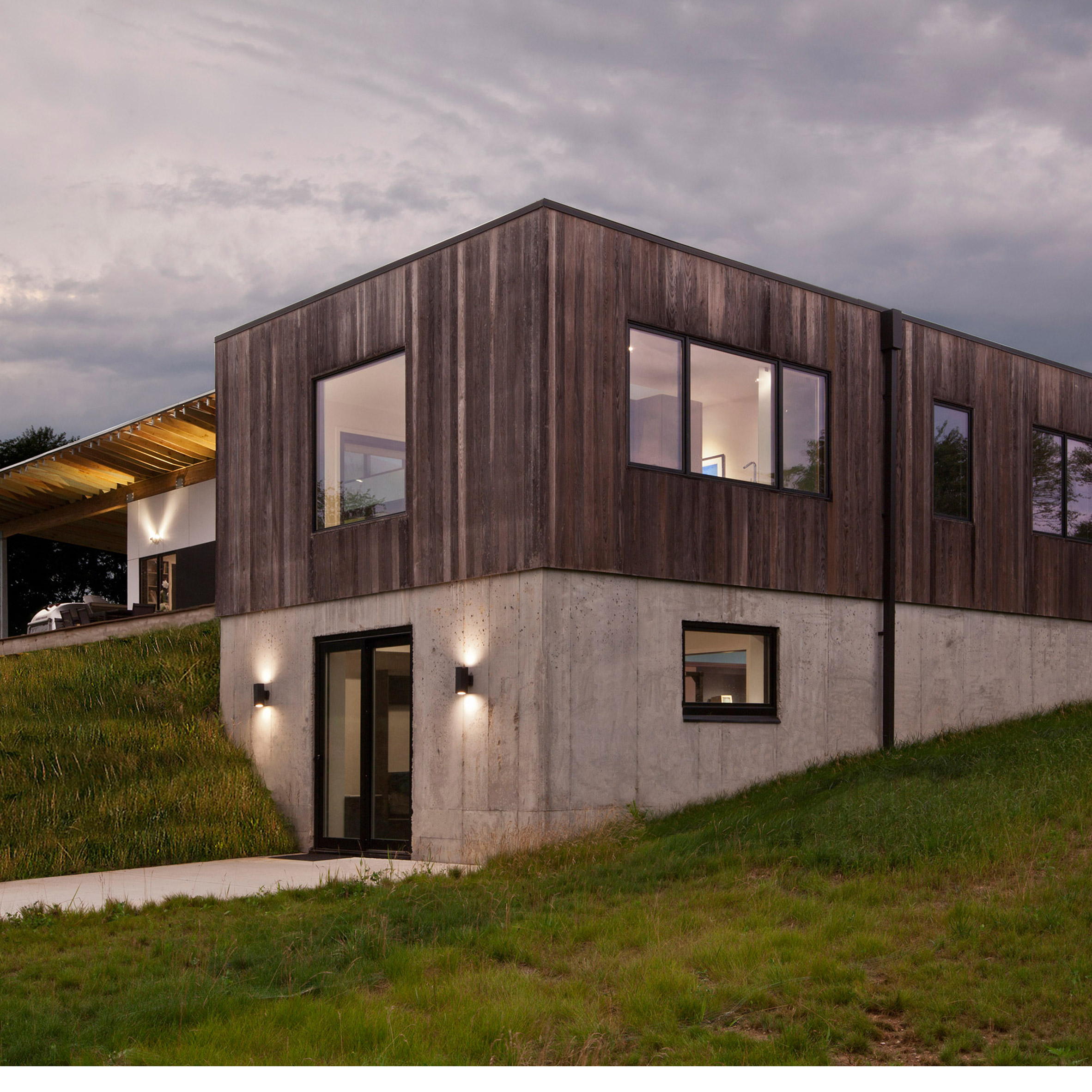 Haus wraps low lying Indiana residence in thermally treated ash