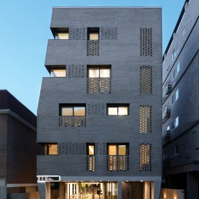 Sosu architects completes brick clad multi generational house in seoul