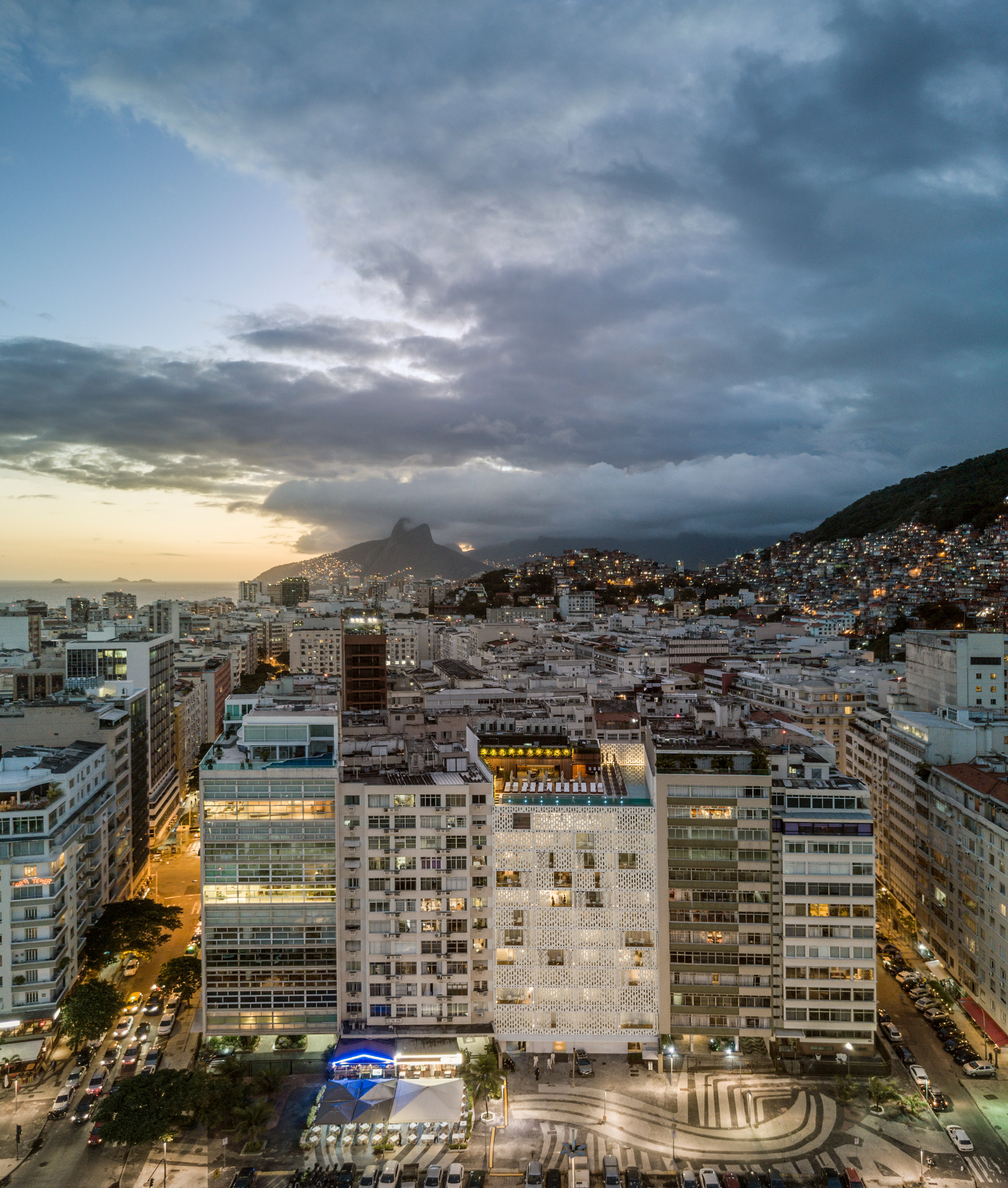 Glazed pool and holey shutters offer Copacabana Beach views from Rio de Janeiro hotel