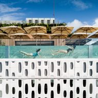 Glazed pool and perforated shutters offer Copacabana views from Rio de Janeiro hotel
