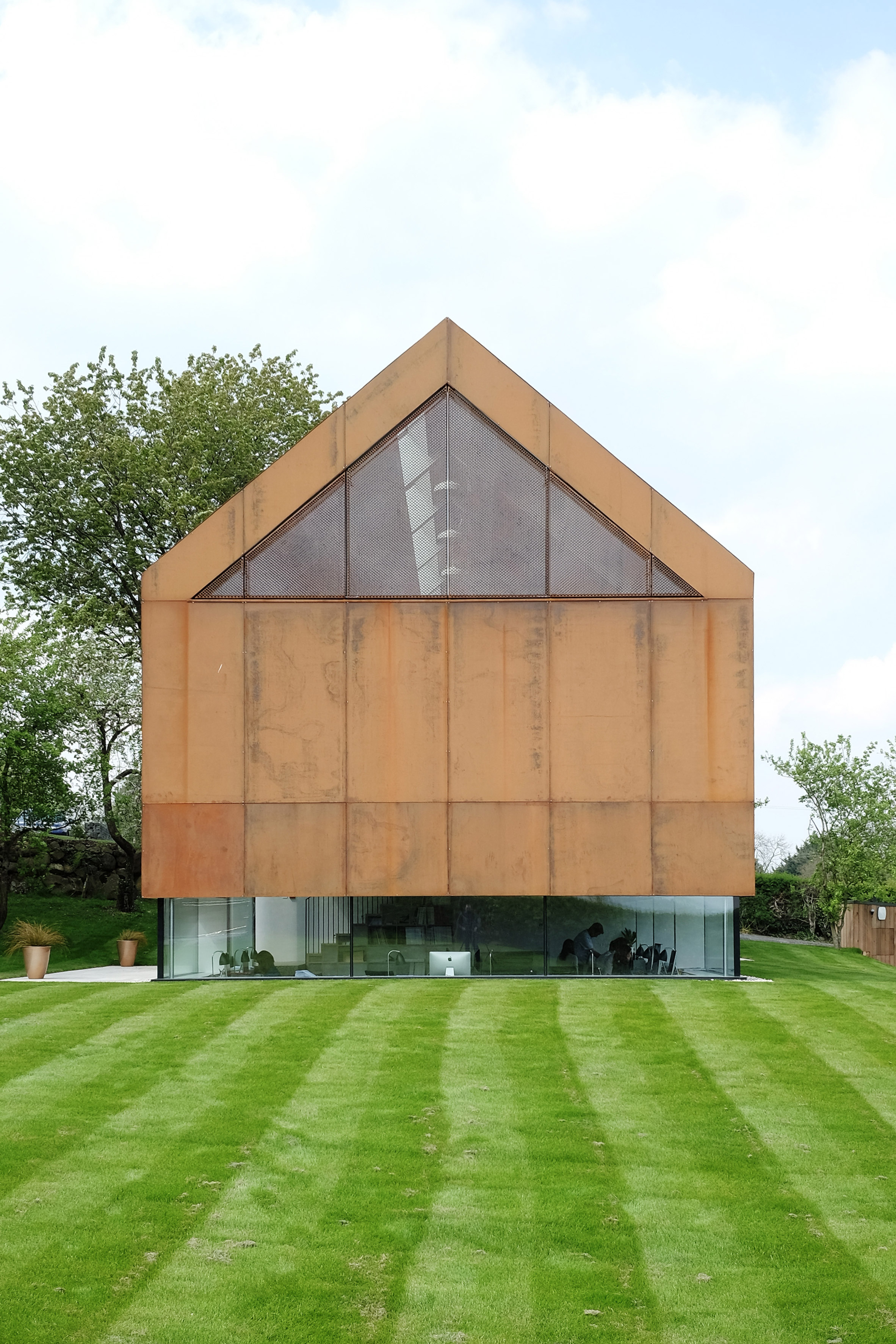 McGarry-Moon's sunken studio in Northern Ireland is topped with a rusty gabled box