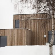 This family home by Danish practice Norm Architects is filled with cosy nooks and opening living areas with generous windows to give views out over picturesque woodland and a lake set around an hour's drive north of Oslo.