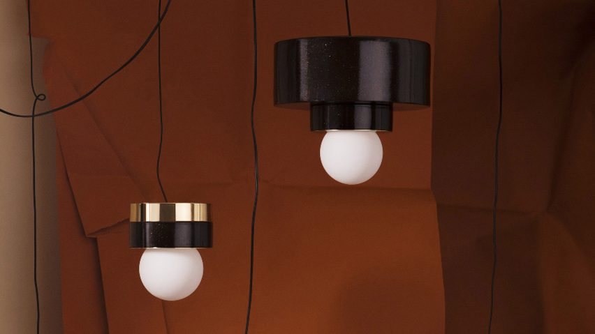 Haos combines layers of wood ceramic and brass to create cylindrical lamps