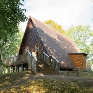 Triangular timber roof shelters the ruins of Sweden's oldest church