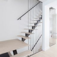 Kl.tz Design renovates light-filled family residence with floating staircase in Montreal