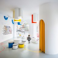 Arched doorways and bold hues appear throughout Little Stories shoe store