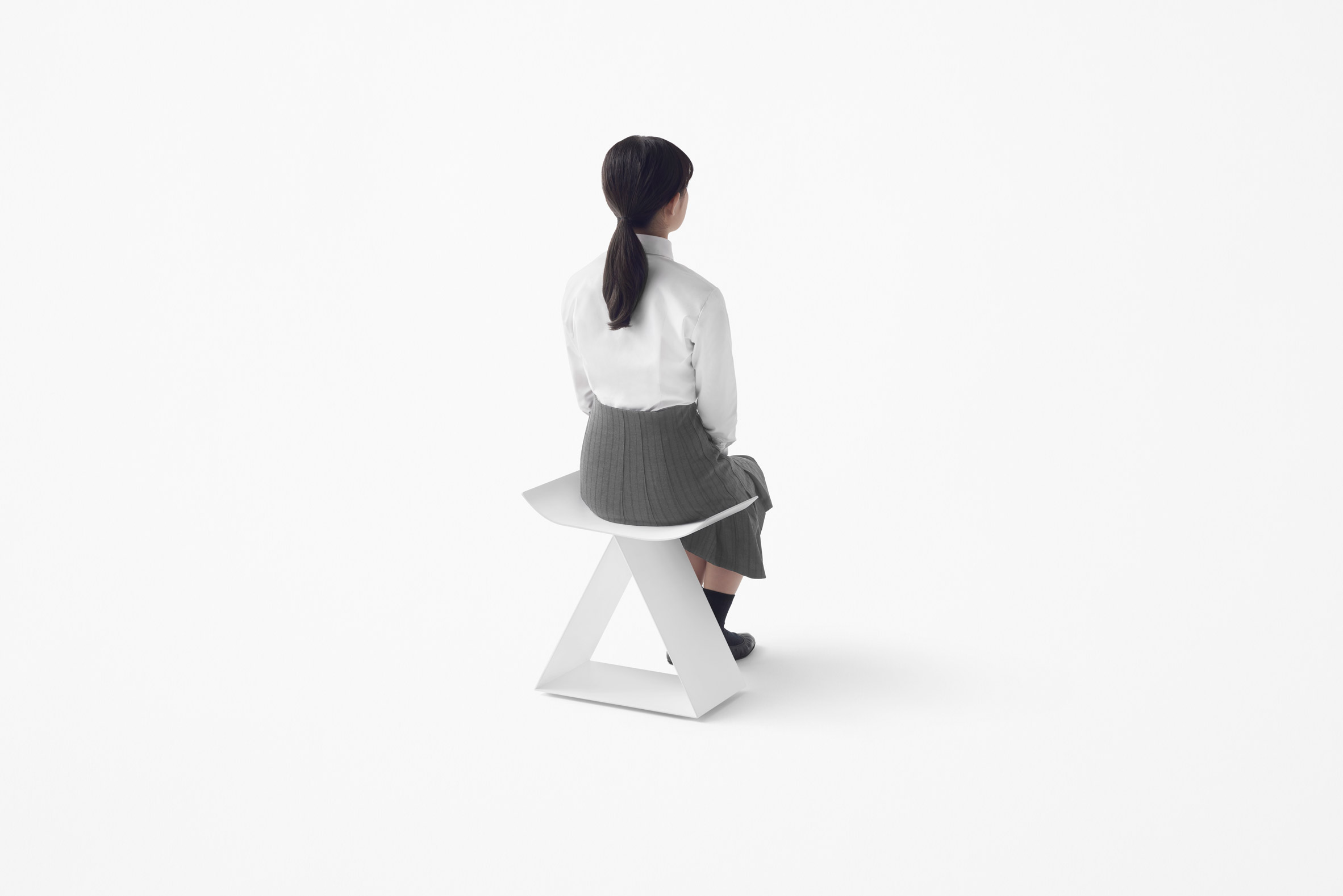 Nendo creates Kanji-inspired furniture and stone-shaped tableware for Zens