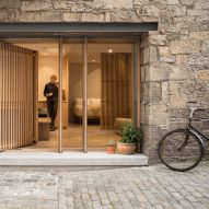 Old Edinburgh workshop transformed into minimal holiday retreat by Izat Arundell