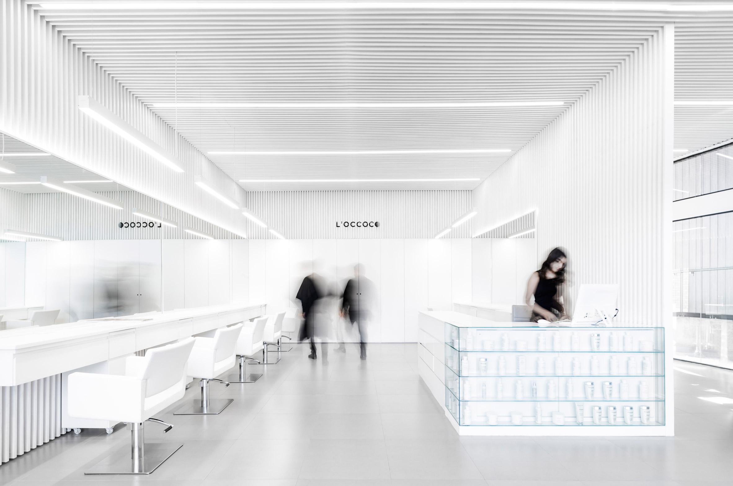 Abraham Cota Paredes creates stark white interior for hair salon in Mexico
