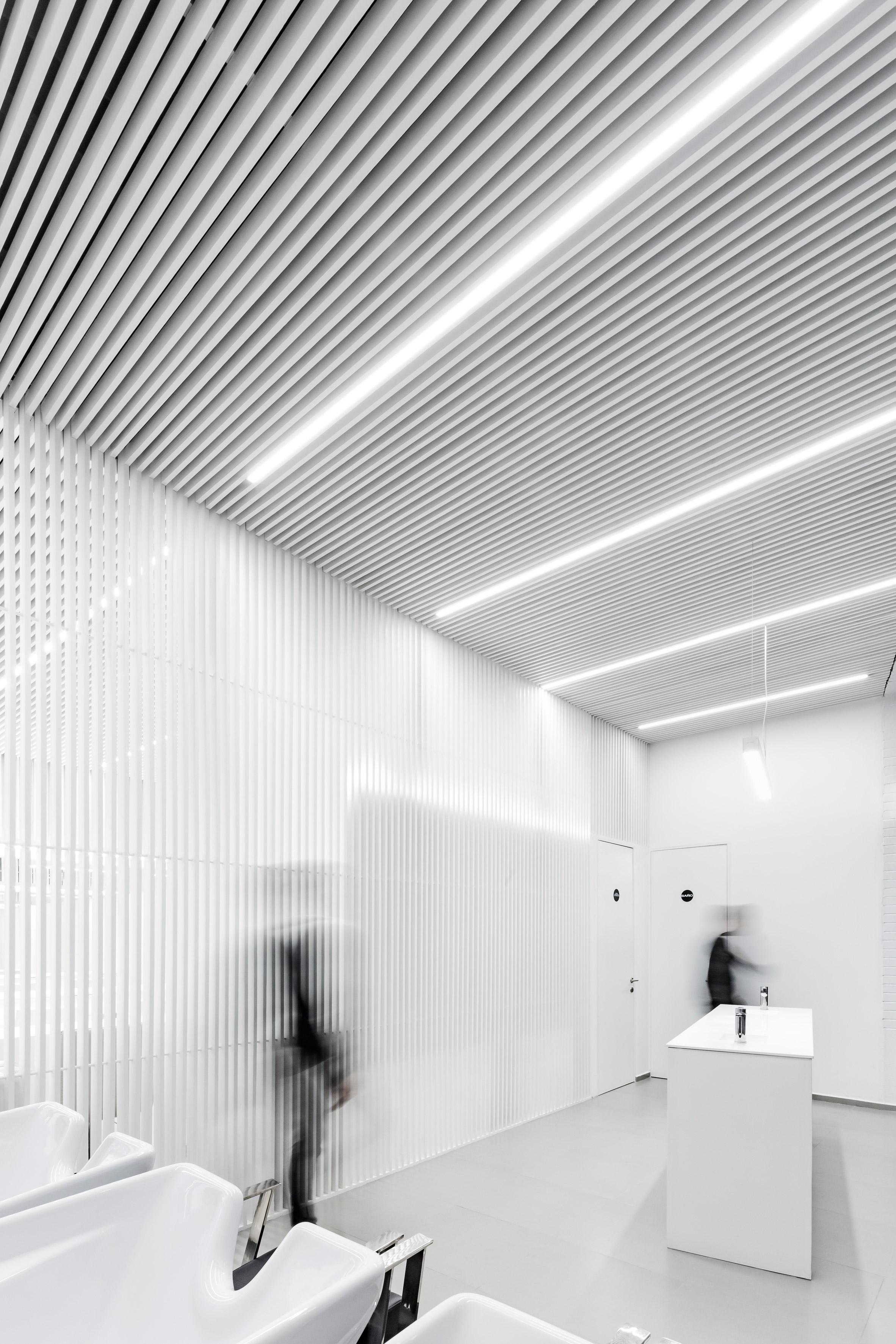 Abraham Cota Paredes creates stark white interior for hair salon in ...