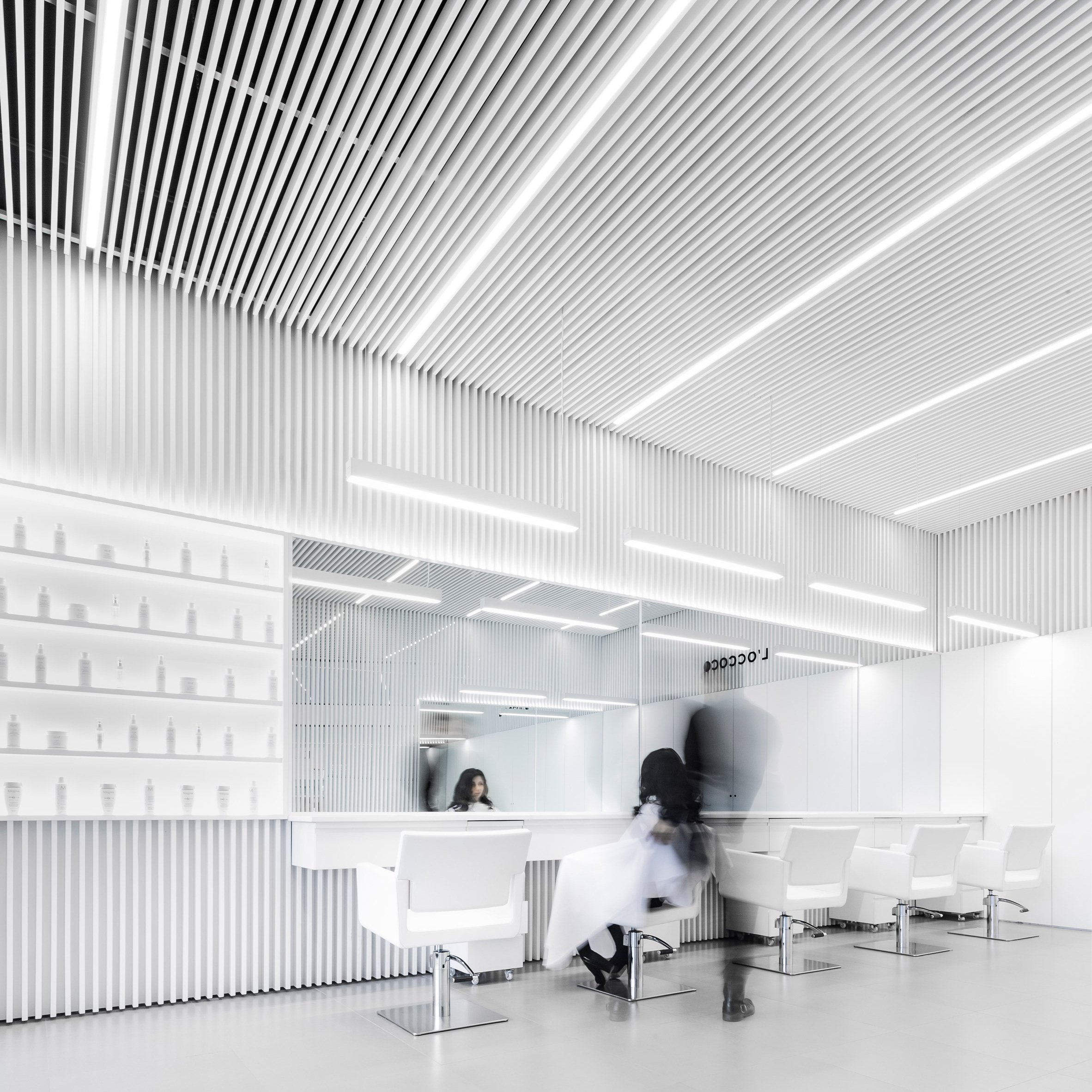 Abraham Cota Paredes creates stark white interior for hair salon in ...