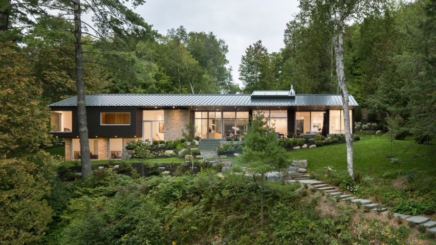 Mu architecture completes black lakefront home with two storey boathouse