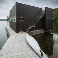 Mu Architecture completes black lakefront home with two-storey boathouse