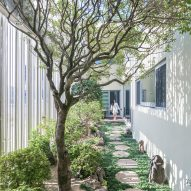 Stainless-steel poles screen living spaces and gardens at South Korean home