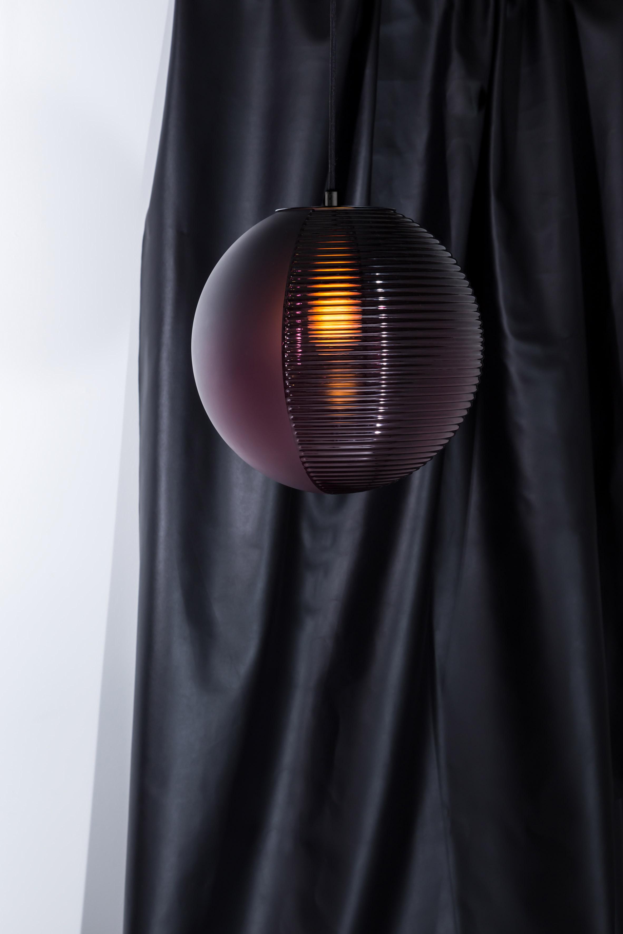 Sebastian Herkner's Stellar lamps fuse two contrasting hemispheres