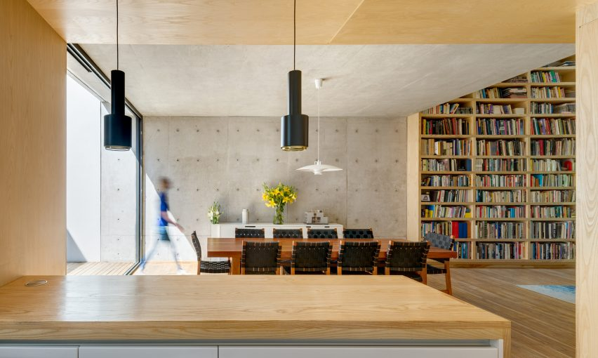 Wooden Staircase Twists Through Concrete And Brick House In