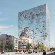 "MVRDV reveals renderings of mirrored ""crystal rock"" office block in Germany"
