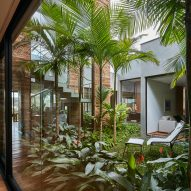 David Guerra wraps Brazilian house around courtyard filled with tropical plants