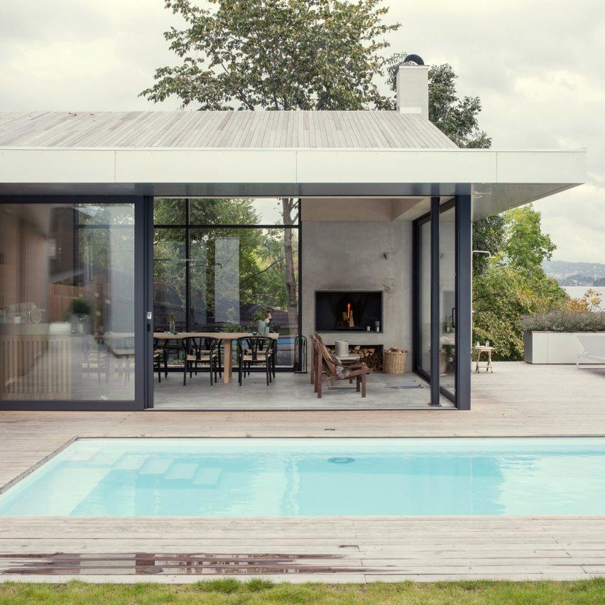 Skapa updates prefabricated Norwegian seafront house with glazed walls