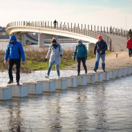 Raised stepping stones allow Dutch bridge to remain accessible during a flood