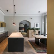 Brass accents and contemporary cabinetry update 19th-century apartment in Vilnius