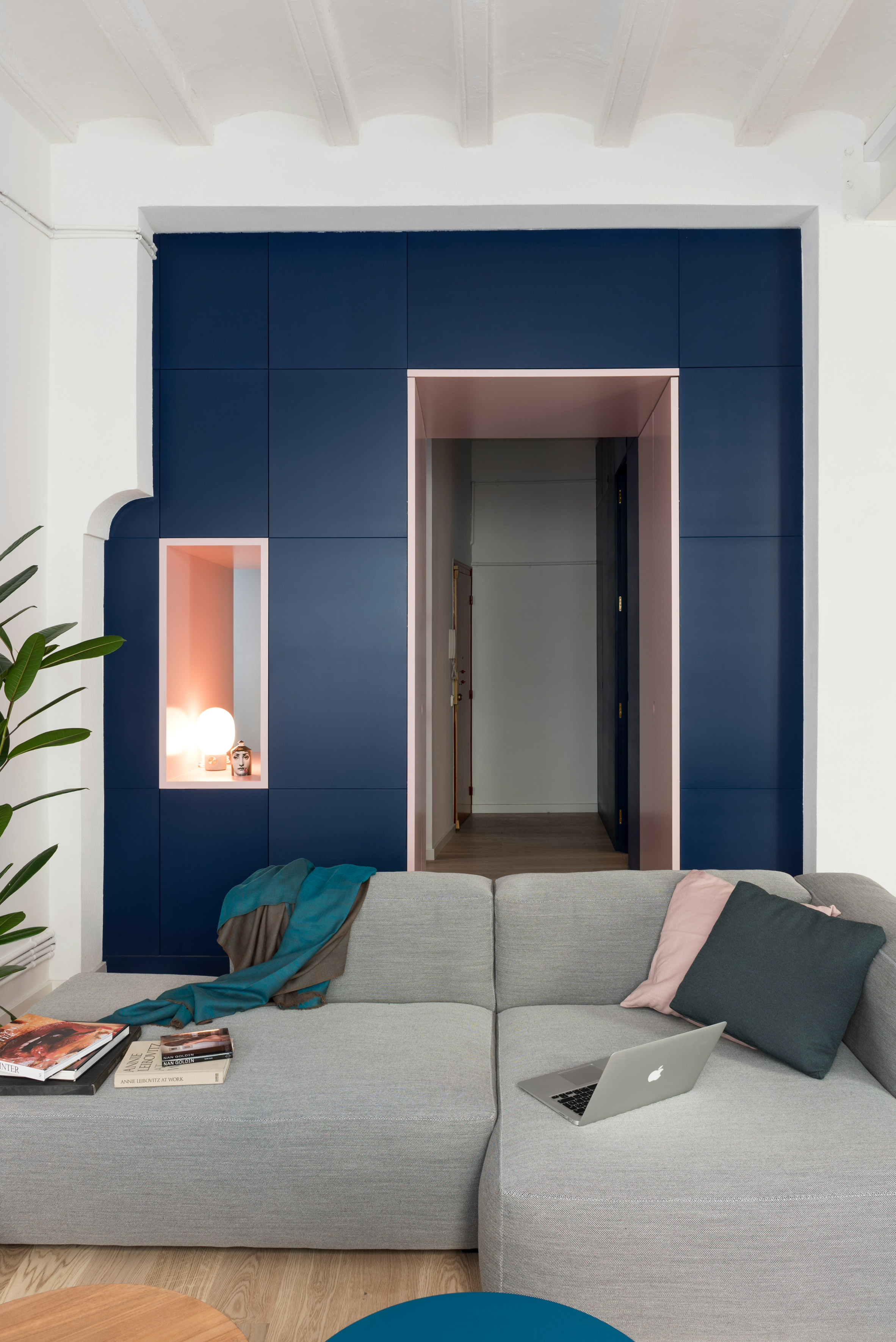 Deep blue cabinetry and coral pink arches redefine Barcelona