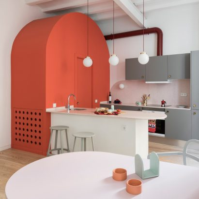 deep blue cabinetry and coral pink arches redefine barcelona apartment