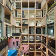 Drone footage reveals 10-storey timber atrium by Studio RHE