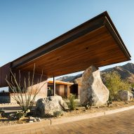 Cantilevered roof extends from Palm Springs guardhouse by Studio AR+D