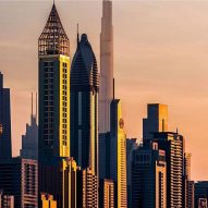 Dubai tower with golden lattice spire named world's tallest hotel