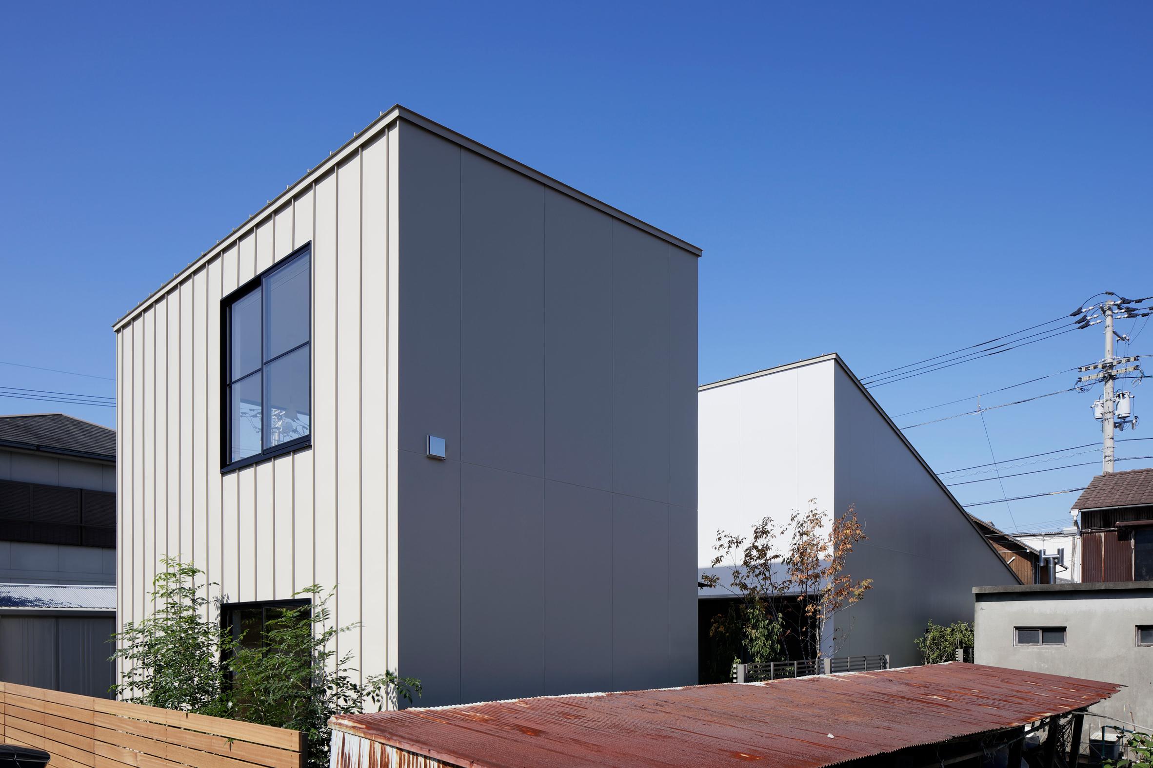Deceptively industrial facade conceals bright contemporary home in Japan