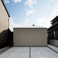 Deceptively industrial facade conceals bright contemporary home in Japan